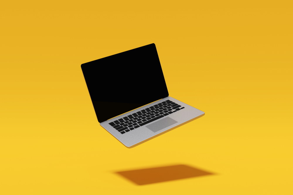 laptop product shot floating in air behind yellow backdrop